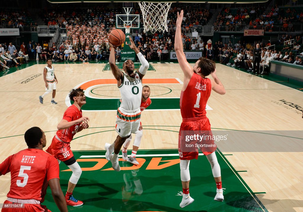 Miami guard Ja'Quan Newton (0) shoots during a college basketball game between the Boston University Terriers and the University of Miami Hurricanes on December 5, 2017 at the Watsco Center, Coral Gables, Florida. Miami defeated Boston U