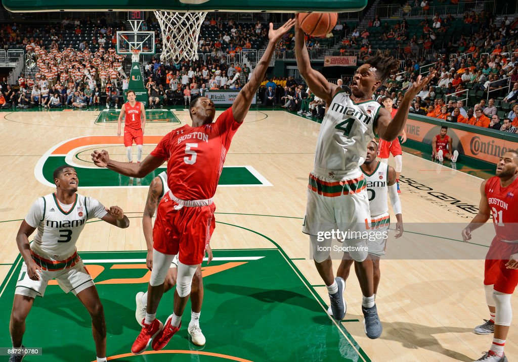 Miami guard Lonnie Walker IV (4) rebounds against Boston U guard/forward Walter Whyte (5) during a college basketball game between the Boston University Terriers and the University of Miami Hurricanes on December 5, 2017 at the Watsco Center, Coral Gables, Florida. Miami defeated Boston U