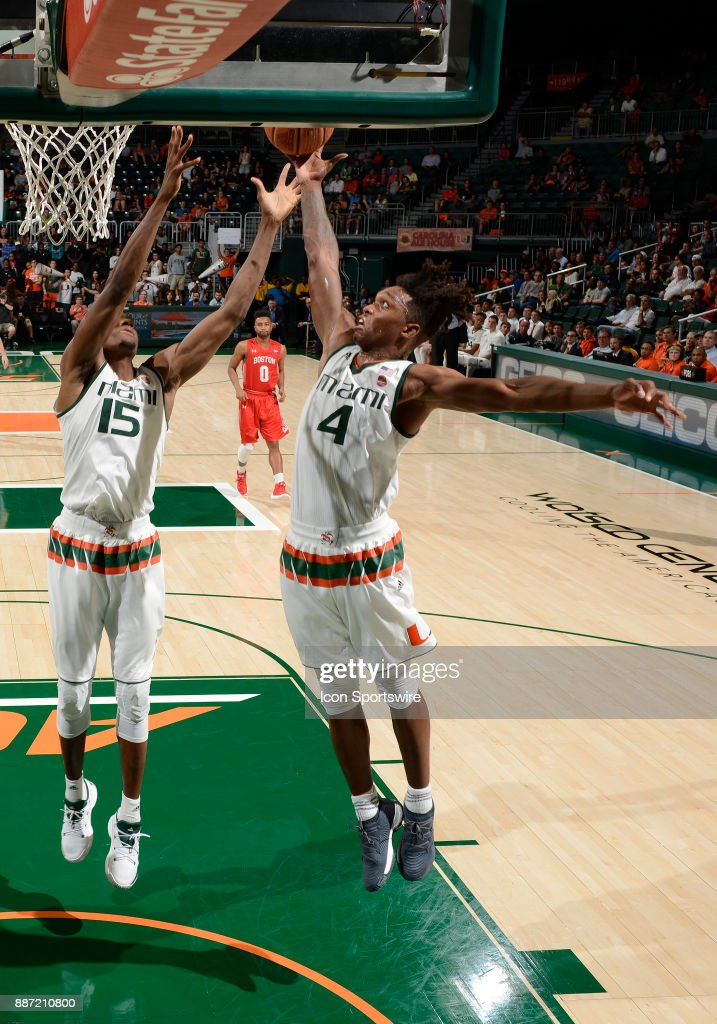Miami guard Lonnie Walker IV (4) rebounds during a college basketball game between the Boston University Terriers and the University of Miami Hurricanes on December 5, 2017 at the Watsco Center, Coral Gables, Florida. Miami defeated Boston U