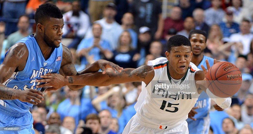 Miami guard Rion Brown (15) beats North Carolina guard/forward Reggie Bullock (35) to a loose ball in the second half. The Miami Hurricanes defeated the North Carolina Tar Heels, 87-77, in the finals of the men's ACC basketball tournament at the Greensboro Coliseum in Greensboro, North Carolina, Sunday, March 17, 2013.
