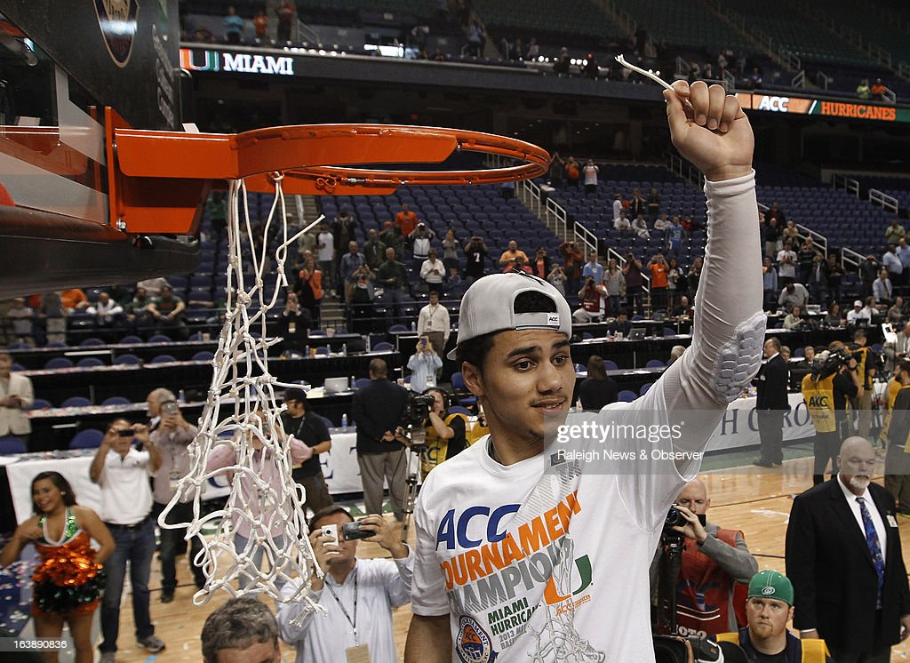 Miami guard Shane Larkin (0), the ACC tournament MVP, holds up his piece of the net after the Hurricanes defeated the North Carolina Tar Heels, 87-77, in the finals of the men's ACC basketball tournament at the Greensboro Coliseum in Greensboro, North Carolina, Sunday, March 17, 2013.