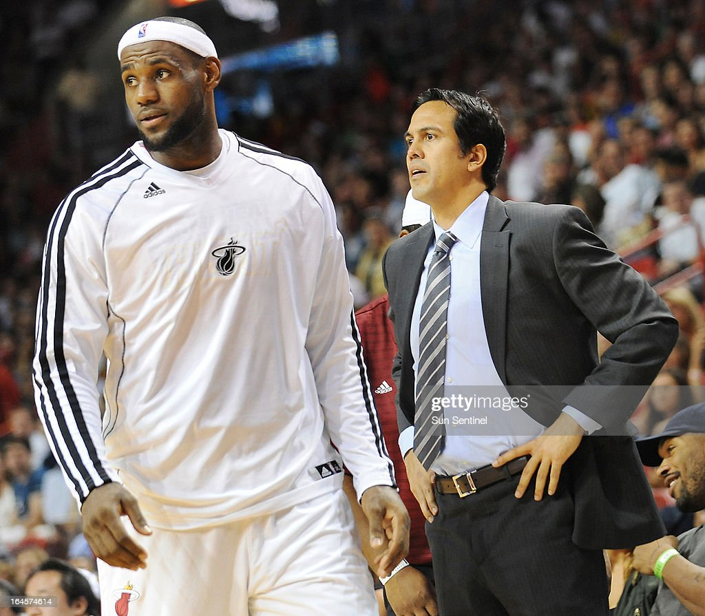 Miami head coach Erik Spoelstra watches the action against the Heat and the Charlotte Bobcats, as LeBron James walks to the bench at AmericanAirlines Arena in Miami, Florida, Sunday, March 24, 2013.