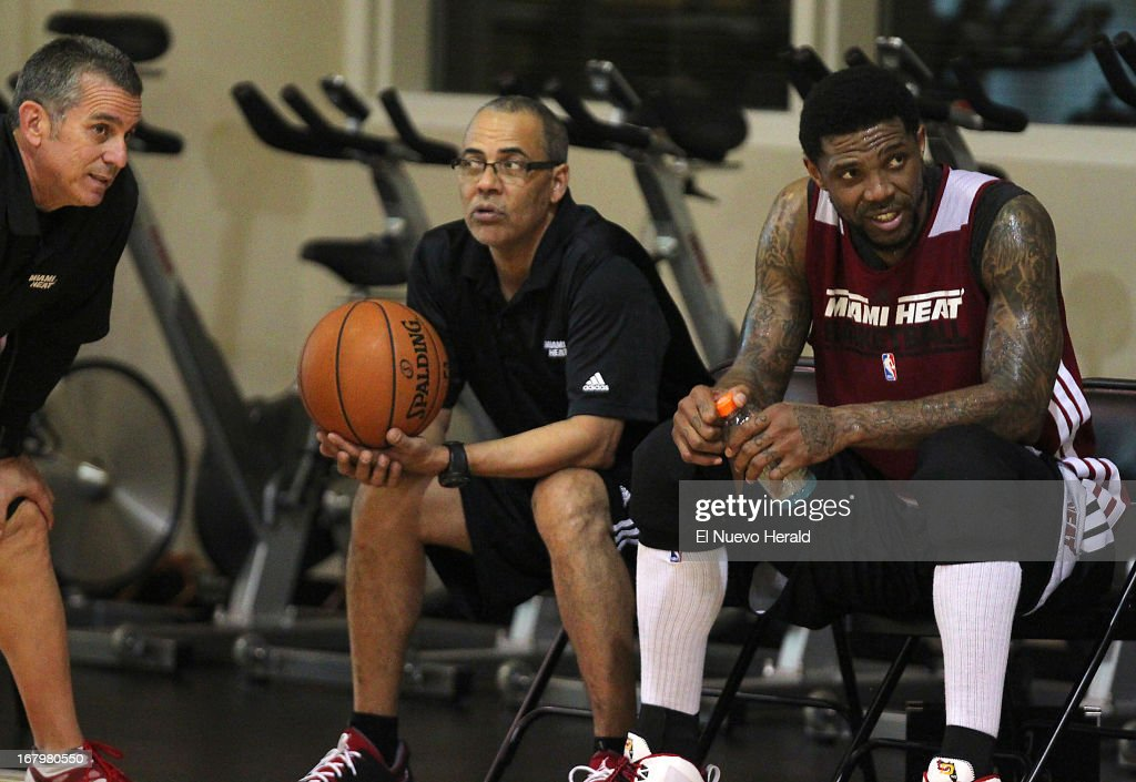 Miami Heat assistant coach Octavio De La Grana, left, Heat team assistant Roger Perez, center, and Heat forward Udonis Haslem sit together during Heat practice at American Airlines Arena in Miami, Florida, Friday, May 3, 2013.