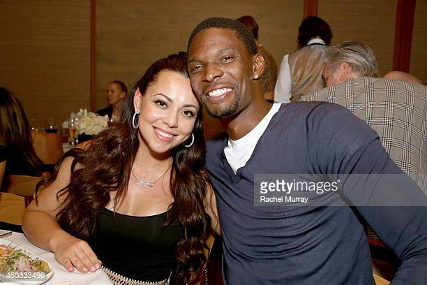 Miami Heat basketball player Chris Bosh and Adrienne Bosh attend Haute Living celebrates the opening of Westime Malibu at Nobu Malibu on August 7...