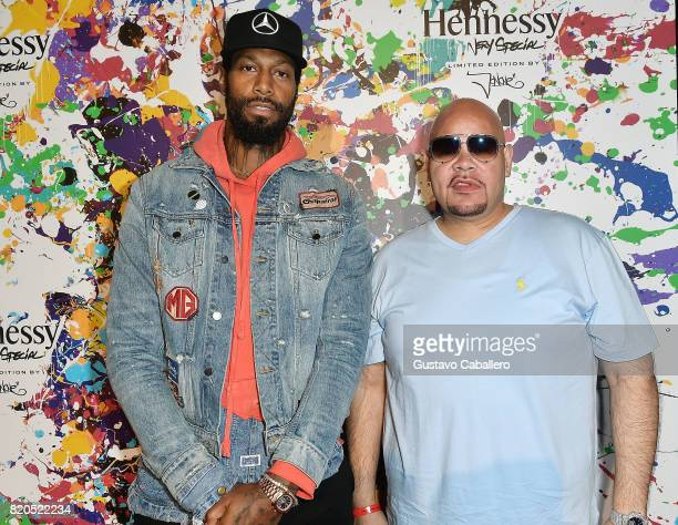 Miami Heat basketball player James Johnson and Miamibased Hip hop artist Fat Joe attend Hennessy VS Limited Edition by JonOne launch party at Cafeina...
