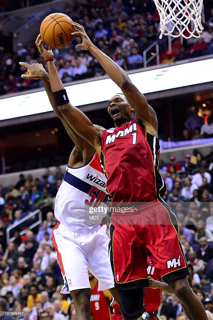Miami Heat center Chris Bosh (1) grabs a rebound over Washington Wizards center Emeka Okafor (50) in the third quarter at the Verizon Center in Washington, D.C., Tuesday, December 4, 2012.