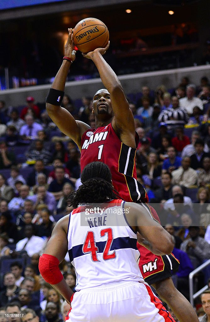Miami Heat center Chris Bosh (1) lines up a jumper over Washington Wizards center Nene (42) in the second quarter at the Verizon Center in Washington, D.C., Tuesday, December 4, 2012.