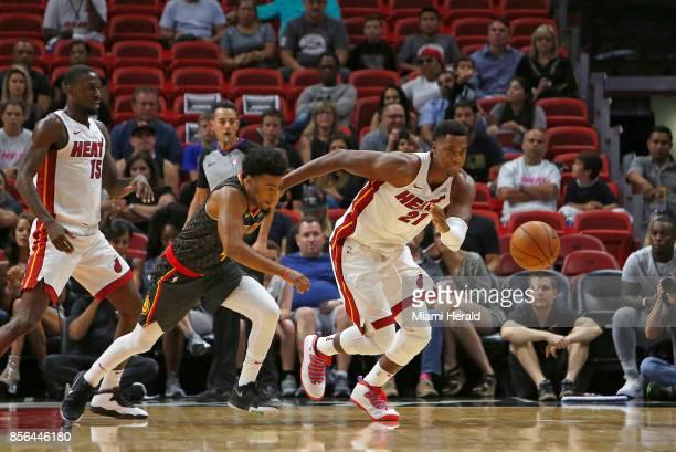Miami Heat center Hassan Whiteside battles for a loose ball against Atlanta Hawks guard Quinn Cook during the second quarter of an NBA preseason...