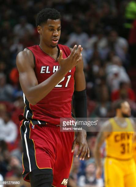 Miami Heat center Hassan Whiteside reacts after a play during the third quarter of an NBA basketball game against the Cleveland Cavaliers at...
