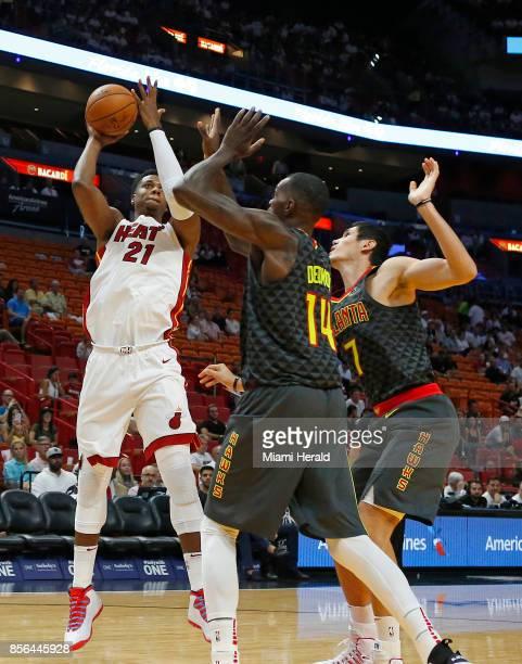 Miami Heat center Hassan Whiteside shoots over Atlanta Hawks forward Ersan Ilyasova and enter Dewayne Dedmon during the first quarter of an NBA...