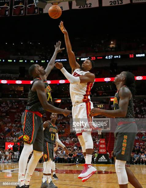 Miami Heat center Hassan Whiteside shoots over Atlanta Hawks forward center Dewayne Dedmon during the second quarter of an NBA preseason basketball...