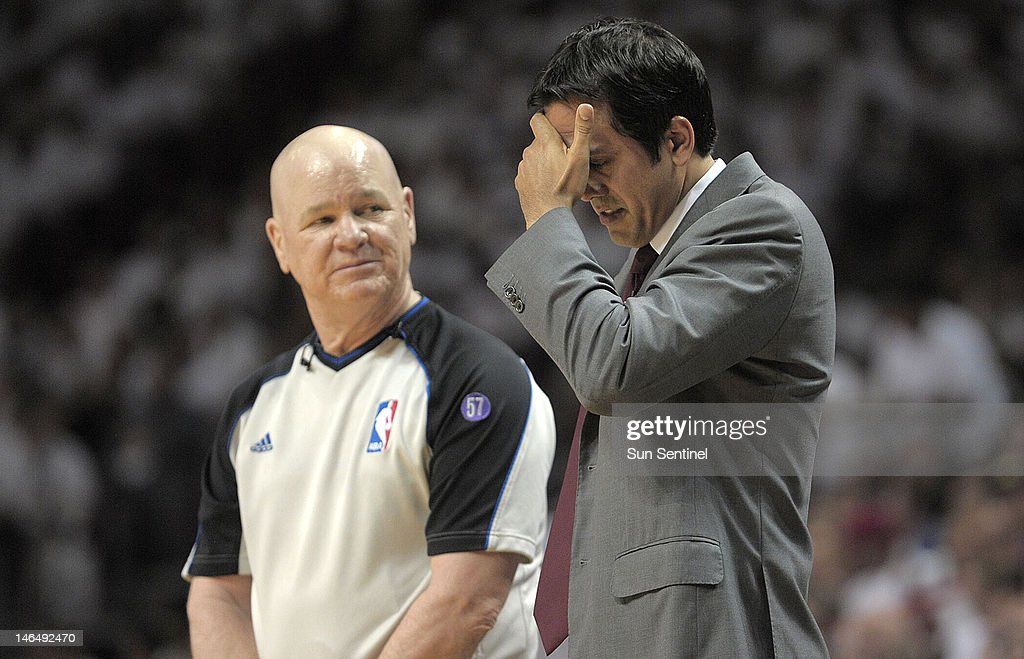 Miami Heat coach Erik Spoelstra talks to referee Joey Crawford after Dwyane Wade was poked in the eye during the second quarter in Game 3 of the NBA Finals at the AmericanAirlines Arena in Miami, Florida on Sunday, June 17, 2012.