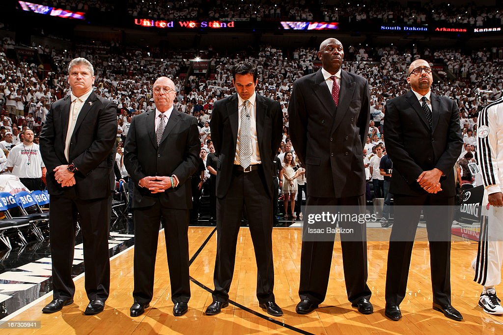 Miami Heat coaching staff members listen to the National Anthem before playing against the Milwaukee Bucks in Game One of the Eastern Conference Quarterfinals during the 2013 NBA Playoffs on April 21, 2013 at American Airlines Arena in Miami, Florida.