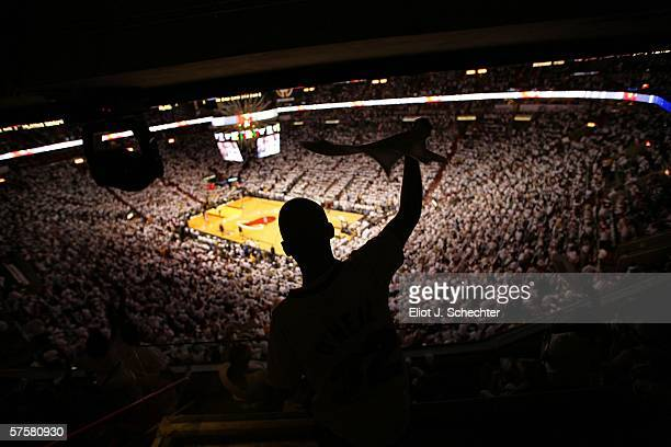 Miami Heat fan Ricardo Ballester cheers on his team against the New Jersey Nets in game two of the Eastern Conference Semifinals during the 2006 NBA...