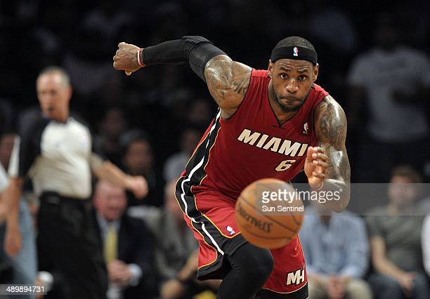 Miami Heat forward LeBron James chases down the ball during the first half in Game 4 of the NBA Eastern Conference playoffs against the Brooklyn Nets...