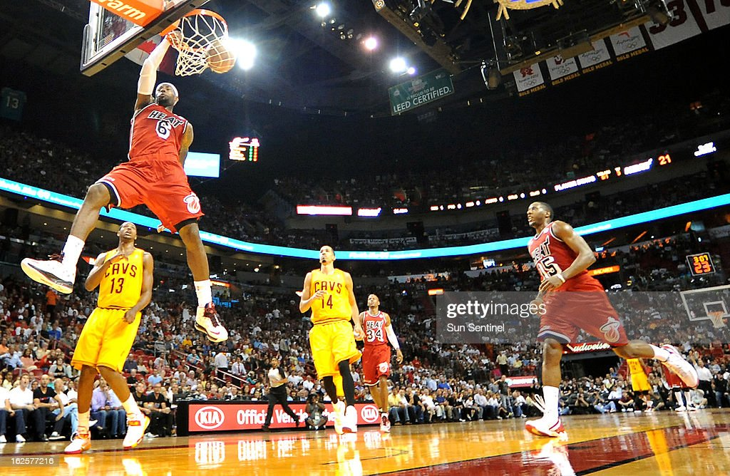 Miami Heat forward LeBron James (6) dunks as Cleveland Cavaliers players Tristan Thompson, left, and Shaun Livingston look on during the first half at the American Airlines Arena in Miami, Florida, Sunday, February 24, 2013.