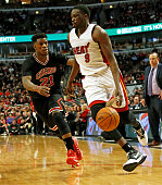 Miami Heat forward Luol Deng drives to the basket past Chicago Bulls guard Jimmy Butler during the third quarter on Sunday Jan 25 at the United...
