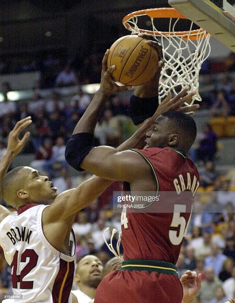 Miami Heat forward P J Brown L and Seattle Supe