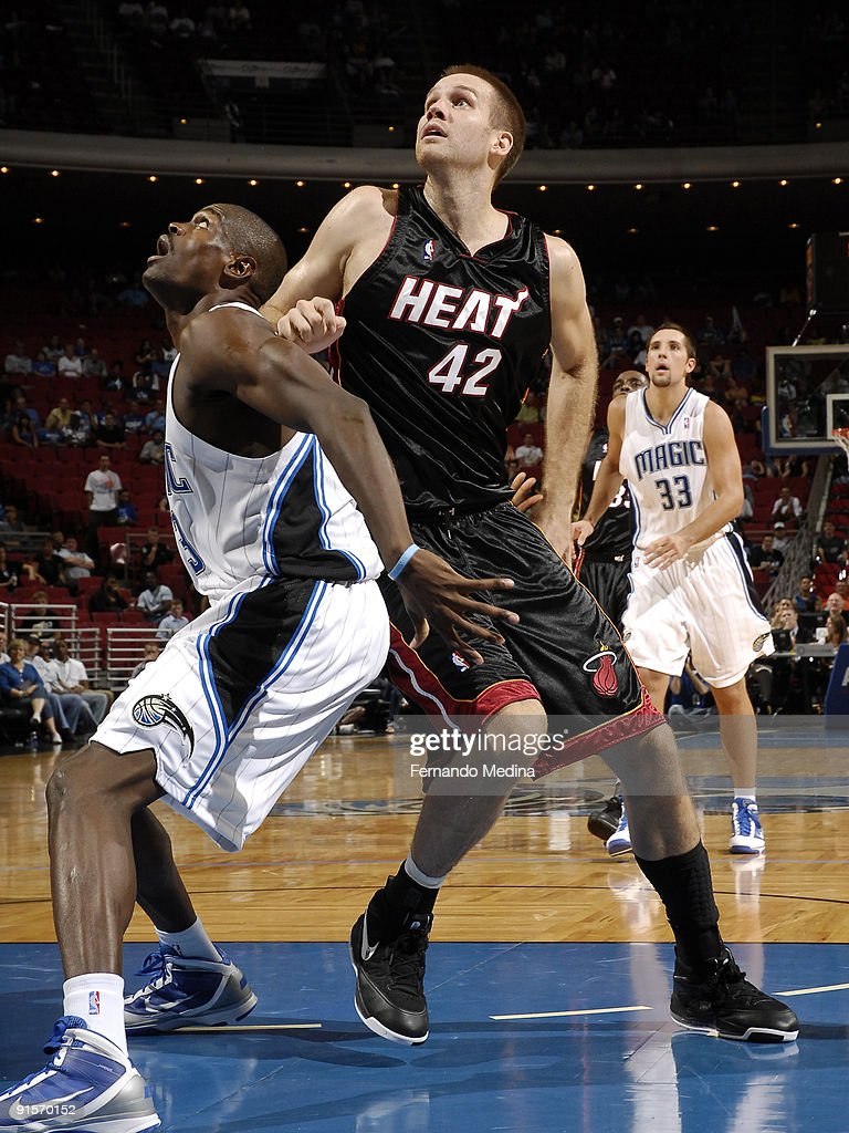 Miami Heat forward <a gi-track='captionPersonalityLinkClicked' href=/galleries/search?phrase=Shavlik+Randolph&family=editorial&specificpeople=210678 ng-click='$event.stopPropagation()'>Shavlik Randolph</a> #42 battles for position in the lane against Orlando Magic forward Linton Johnson #43 during the pre-season game on October 7, 2008 at Amway Arena in Orlando, Florida.