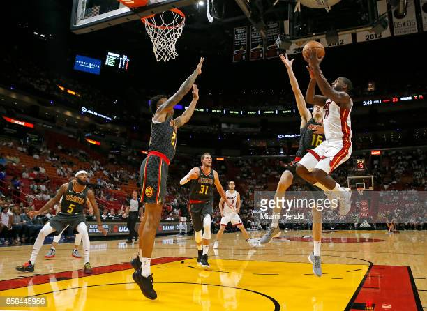 Miami Heat guard Dion Waiters goes to the basket against Atlanta Hawks forward Nicolas Brussino during the first quarter of an NBA preseason...