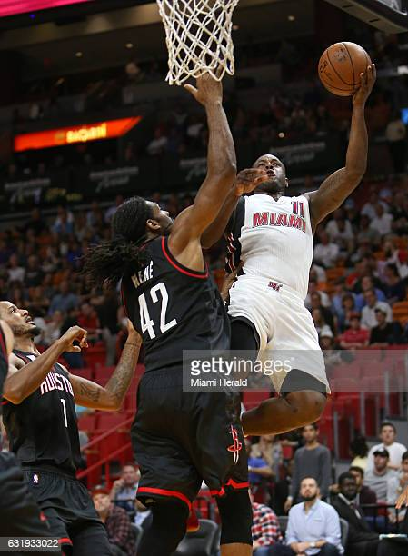 Miami Heat guard Dion Waiters goes to the basket against Houston Rockets center Nene Hilario during the first quarter of an NBA basketball game at...
