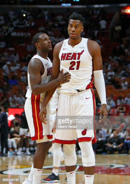 Miami Heat guard Dion Waiters talks with center Hassan Whiteside during the second quarter of an NBA preseason basketball game against the Atlanta...