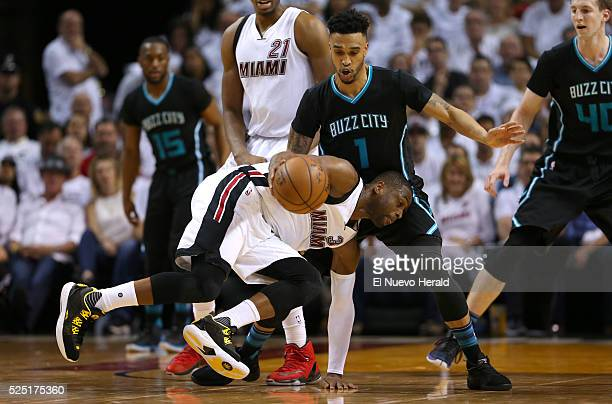 Miami Heat guard Dwyane Wade drives against Charlotte Hornets guard Courtney Lee during the first quarter on Wednesday April 27 at AmericanAirlines...