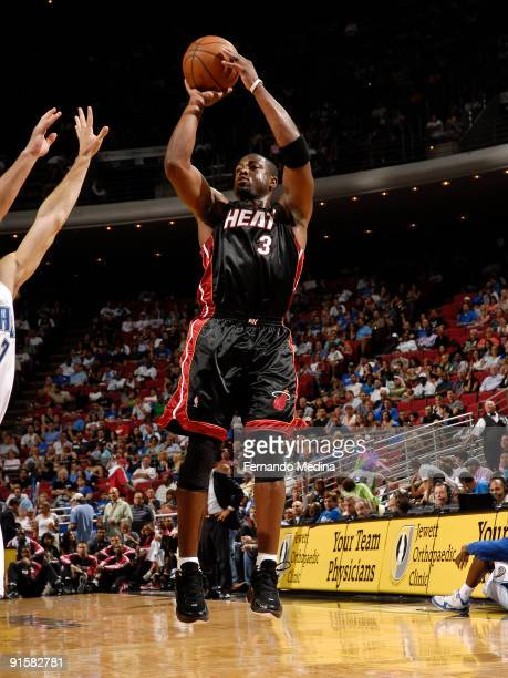 Miami Heat guard Dwyane Wade shoots against the Orlando Magic during the preseason game on October 7 2008 at Amway Arena in Orlando Florida NOTE TO...