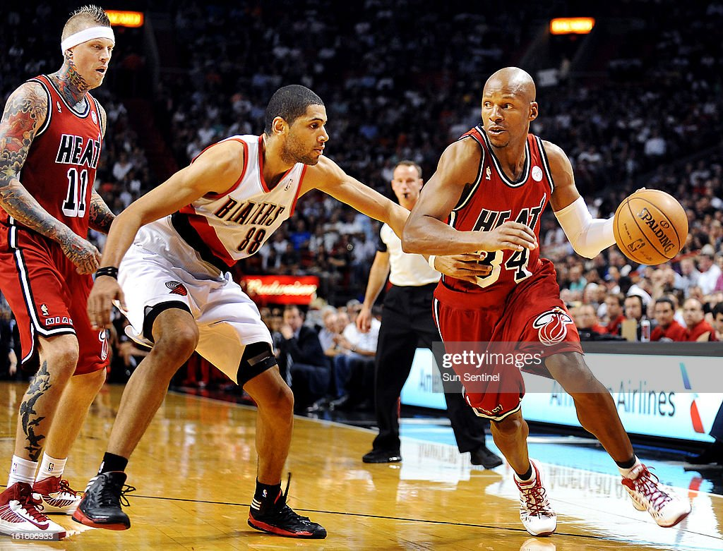 Miami Heat guard Ray Allen, right, works past Portland Trail Blazers defennder Nicolas Batum in the first half at the American Airlines Arena in Miami, Florida, Tuesday, February 12, 2013. The Heat beat the Blazer, 117-104.