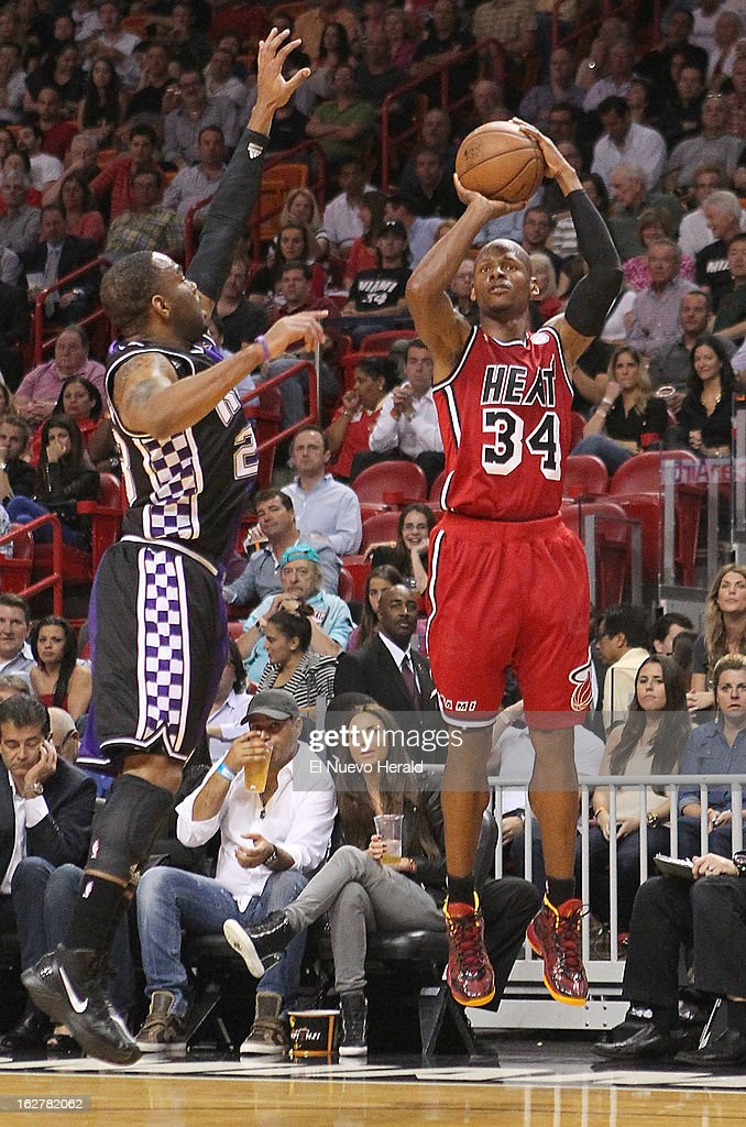 Miami Heat guard Ray Allen shoots a three-point shoots against Sacramento Kings defender Marcus Thornton in the second quarter at the American Airlines Arena in Miami, Florida, Tuesday, February 26, 2013. The Heat defeated the Kings in double overtime, 141-129.