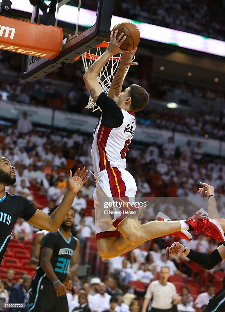 Miami Heat guard Tyler Johnson goes to the basket against Charlotte Hornets guard Aaron Harrison left during the fourth quarter on Sunday May 1 at...