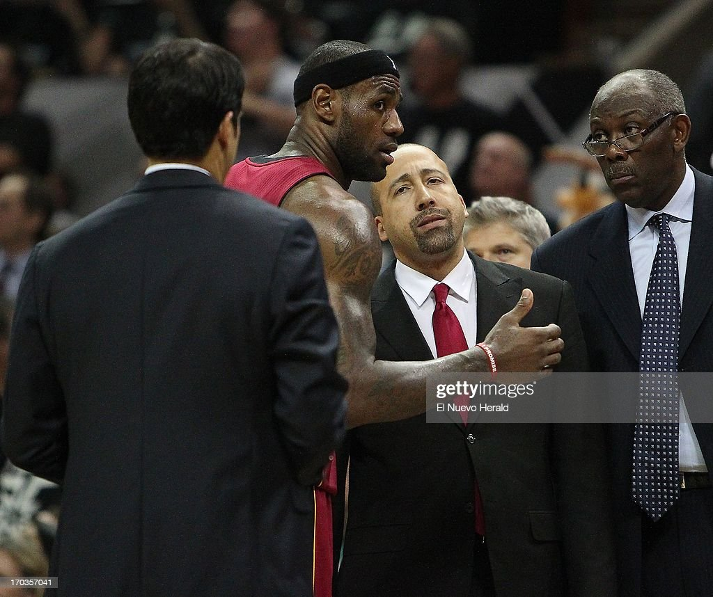 Miami Heat head coach Erik Spoelstra, from left, talks with Heat forward LeBron James, Heat assistant coach David Fizdale and Heat Bob McAdoo during the fourth quarter in Game 3 of the NBA Finals, Tuesday, June 11, 2013, at the AT&T Center in San Antonio, Texas.