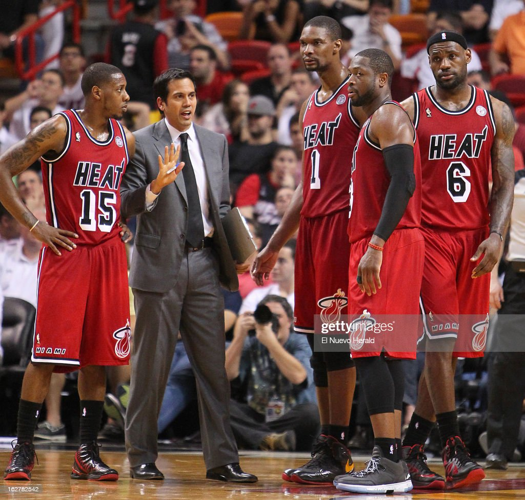 Miami Heat head coach Erik Spoelstra, gives instructions to Mario Chalmers,(15), Chris Bosh,(1), Dwyane Wade,(3), and LeBron James,(6) during overtime against the Sacramento Kings at the American Airlines Arena in Miami, Florida, Tuesday, February 26, 2013. The Heat defeated the Kings in double overtime, 141-129.