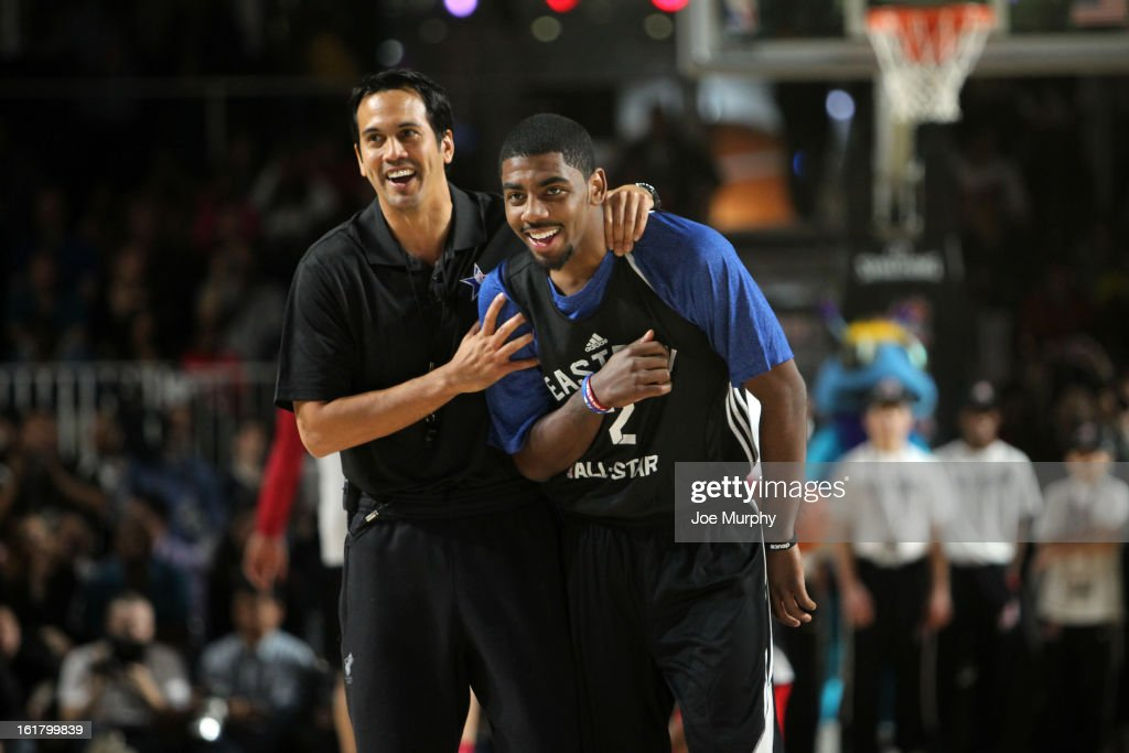 Miami Heat head coach Erik Spoelstra laughs with Kyrie irving #2 of the Cleveland Cavaliers during the NBA All-Star Practice in Sprint Arena during the 2013 NBA All-Star Weekend on February 16, 2013 at the George R. Brown Convention Center in Houston, Texas.