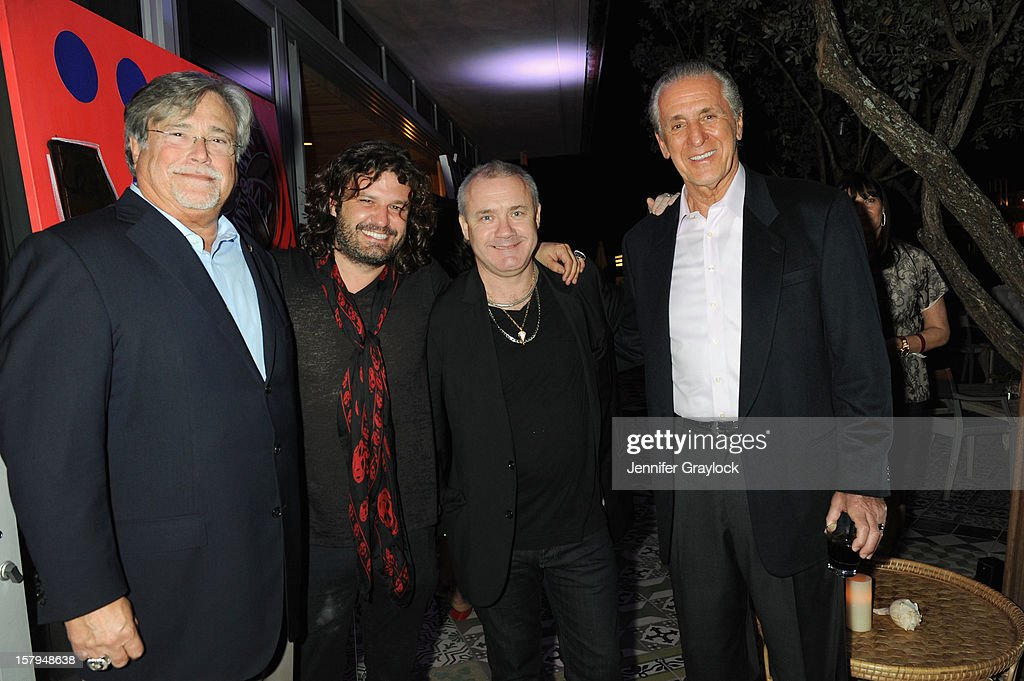 Miami Heat Managing General Partner Micky Arison artist Domingo Zapata artist Damien Hirst and Miami Heat President Pat Riley attend the Haute Living...