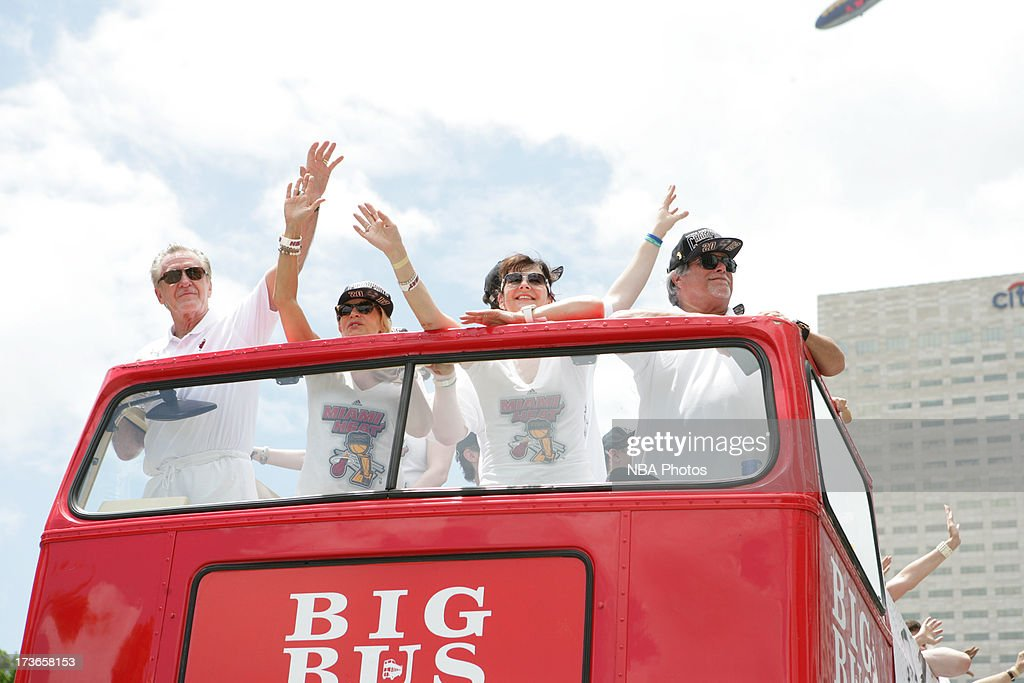 Miami Heat owner Mickey Arison celebrates with team President Pat Riley during the NBA championship parade through downtown Miami on June 24 2013 in...
