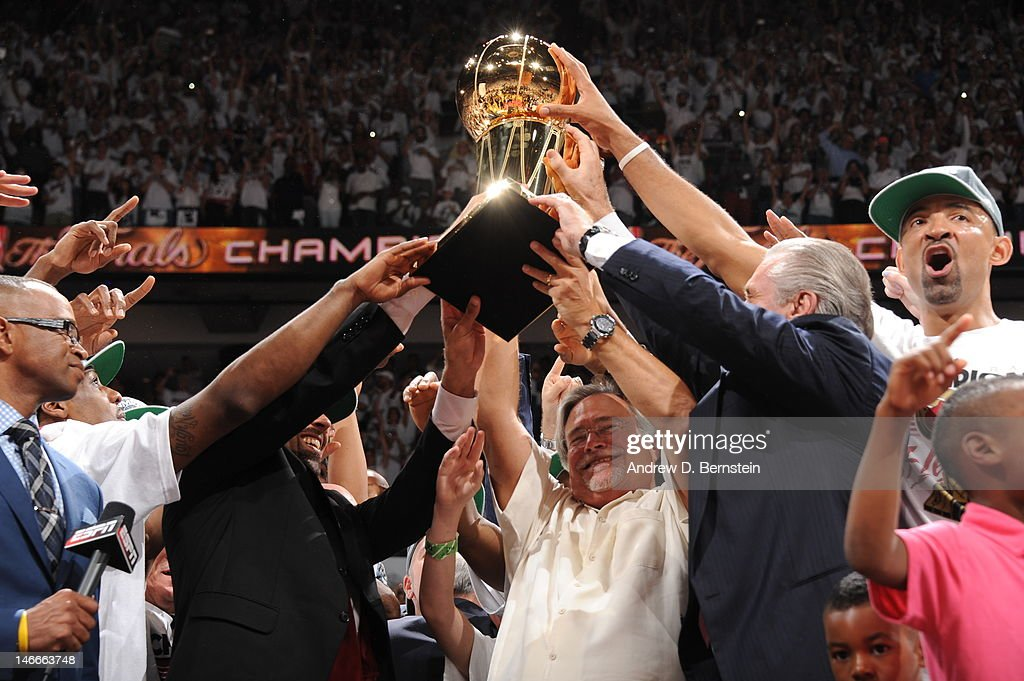 Miami Heat owner Micky Arison holds up the Larry O'Brien NBA Championship Trophy after the team's victory in Game Five of the 2012 NBA Finals between the Miami Heat and the Oklahoma City Thunder at American Airlines Arena on June 21, 2012 in Miami, Florida.