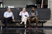 Miami Heat owner Micky Arison President Pat Riley and LeBron James speak as part of the 2014 NBA Finals on June 6 2014 at the Spurs Practice Facility...