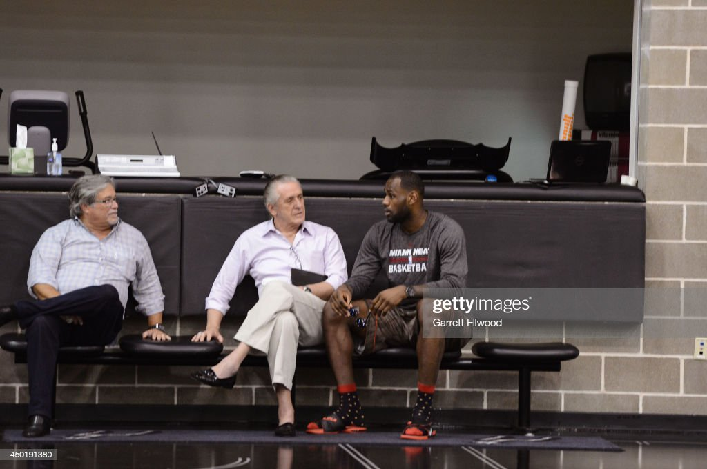Miami Heat owner Micky Arison President Pat Riley and LeBron James speak during practice as part of the 2014 NBA Finals on June 6 2014 at the Spurs...
