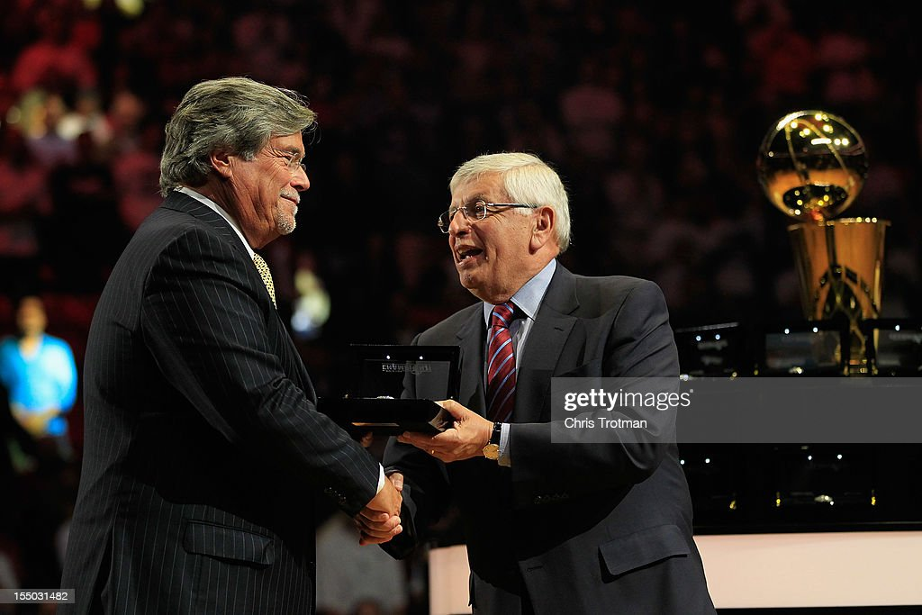 Miami Heat owner Micky Arison receives his 2012 NBA Championship ring from (R) NBA Commissioner David Stern prior to the game against the Boston Celtics at American Airlines Arena on October 30, 2012 in Miami, Florida.