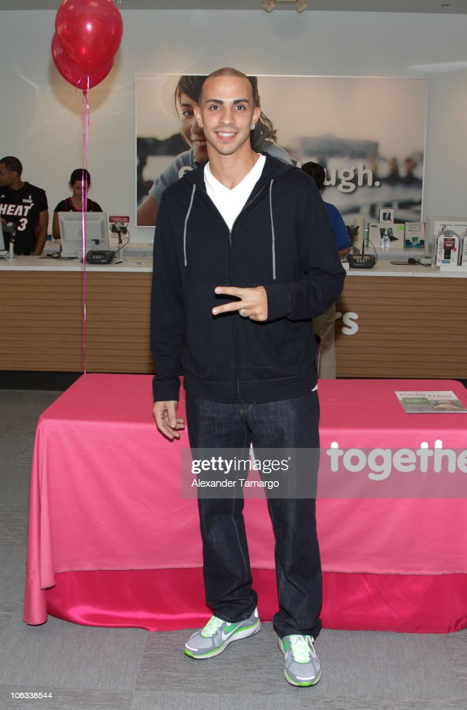 Miami HEAT player <a gi-track='captionPersonalityLinkClicked' href=/galleries/search?phrase=Carlos+Arroyo&family=editorial&specificpeople=201991 ng-click='$event.stopPropagation()'>Carlos Arroyo</a> makes an appearance at a T-Mobile store to greet fans and sign autographs at a T-Mobile Store on October 28, 2010 in Miami, Florida.