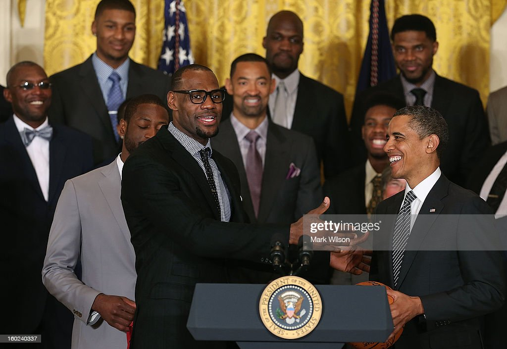 Miami Heat player <a gi-track='captionPersonalityLinkClicked' href=/galleries/search?phrase=LeBron+James&family=editorial&specificpeople=201474 ng-click='$event.stopPropagation()'>LeBron James</a> (L) speaks to U.S. President <a gi-track='captionPersonalityLinkClicked' href=/galleries/search?phrase=Barack+Obama&family=editorial&specificpeople=203260 ng-click='$event.stopPropagation()'>Barack Obama</a> (R) during an event to honor the NBA champion Miami Heat in the East Room at the White House on January 28, 2013 in Washington, DC. President <a gi-track='captionPersonalityLinkClicked' href=/galleries/search?phrase=Barack+Obama&family=editorial&specificpeople=203260 ng-click='$event.stopPropagation()'>Barack Obama</a> congratulated the 2012 NBA champions for claiming their third NBA Championship by beating the Boston Celtics.