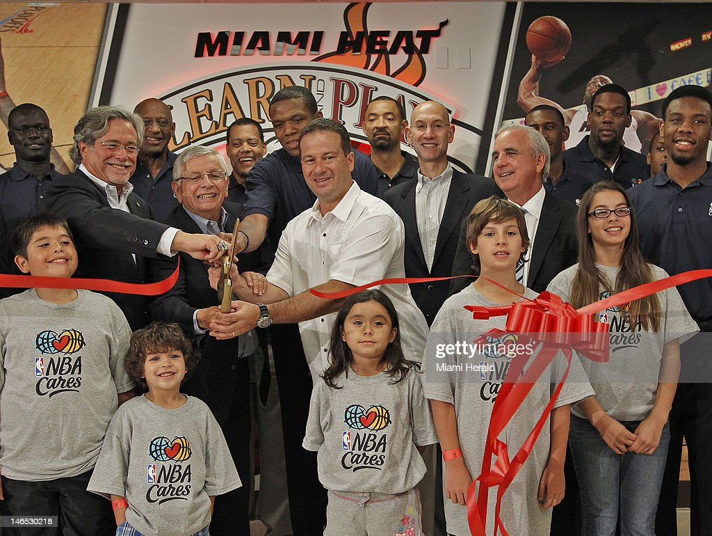 Miami Heat players, children, basketball Hall of Famers, and local officials were all on hand to help Micky Arison, left, Commissioner David Stern, Heat forward James Jones, and Miami Springs mayor, Zavier Garcia, right, cut the red ribbon at the grand opening ceremony of the NBA Learning Place. NBA and Miami Heat executives along with local politicians attended the opening ceremony of the NBA Learning Place ribbon cutting at Miami Springs Community Center in Miami Springs, Florida on Monday, June 18, 2012.