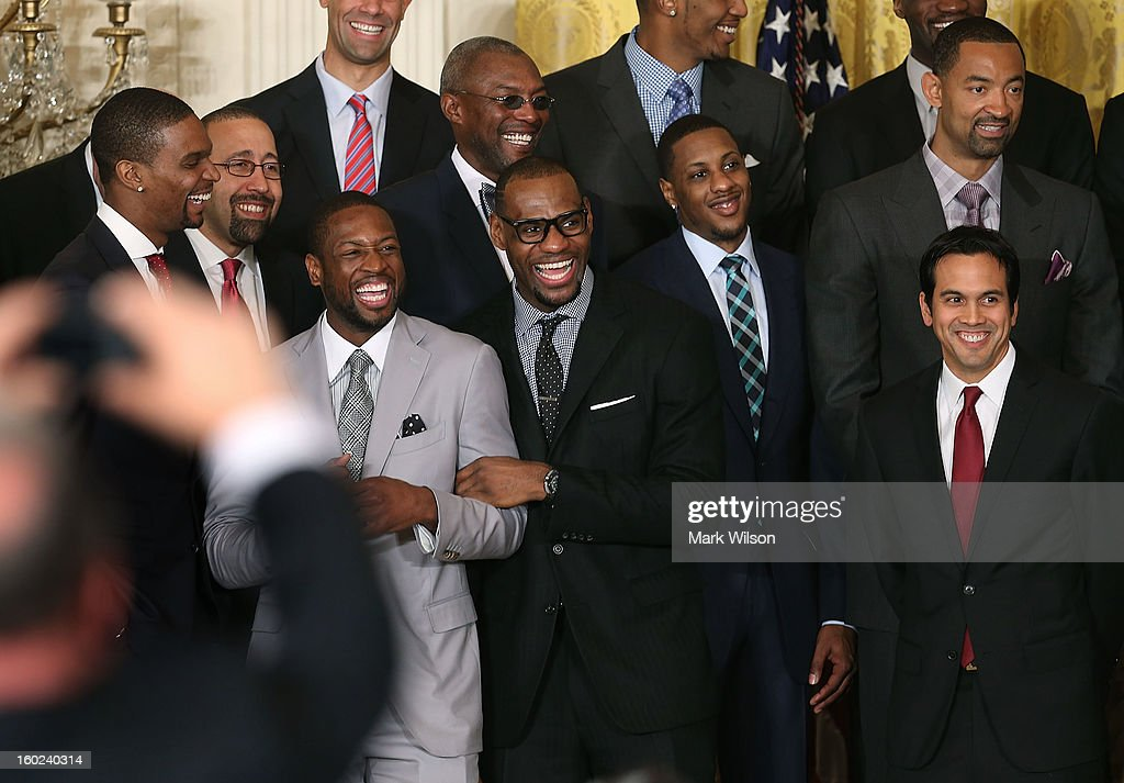 Miami Heat players, (L-R) Chris Bosh, Dwyane Wade, LeBron James, Mario Chalmers, and head coach Erik Spoelstra share a laugh during an event to honor the NBA champion Miami Heat in the East Room at the White House on January 28, 2013 in Washington, DC. President Barack Obama congratulated the 2012 NBA champions for claiming their third NBA Championship by beating the Boston Celtics.