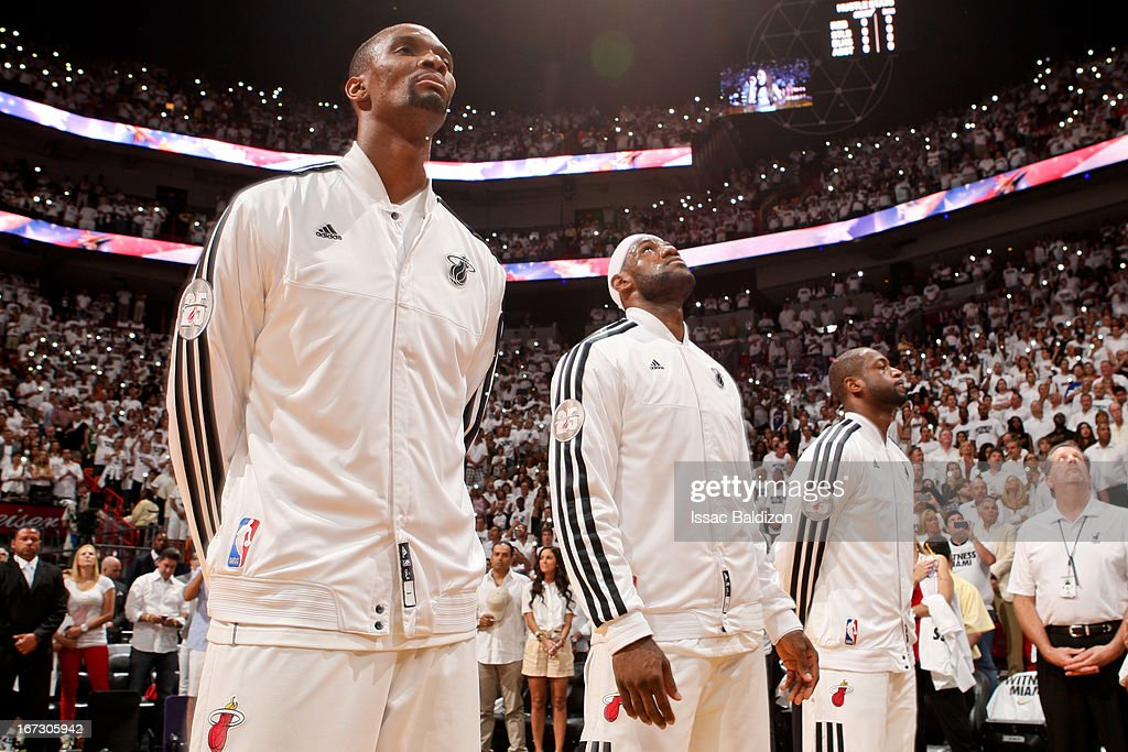Miami Heat players, from left, Chris Bosh #1, LeBron James #6 and Dwyane Wade #3 listen to the National Anthem before playing against the Milwaukee Bucks in Game One of the Eastern Conference Quarterfinals during the 2013 NBA Playoffs on April 21, 2013 at American Airlines Arena in Miami, Florida.