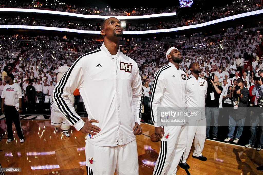 Miami Heat players, from left, Chris Bosh #1, LeBron James #6 and Dwyane Wade #3 listen to the National Anthem before playing against the Indiana Pacers in Game One of the Eastern Conference Finals during the 2013 NBA Playoffs on May 22, 2013 at American Airlines Arena in Miami, Florida.