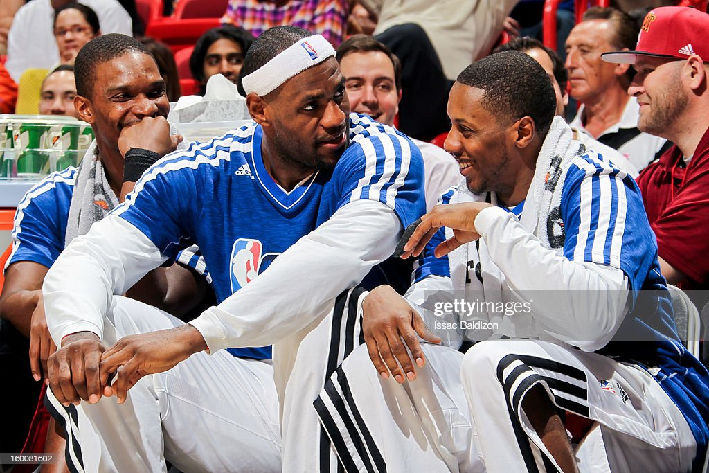 Miami Heat players, from left, Chris Bosh #1, LeBron James #6 and Mario Chalmers #15 share a laugh on the bench during a game against the Detroit Pistons on January 25, 2013 at American Airlines Arena in Miami, Florida.