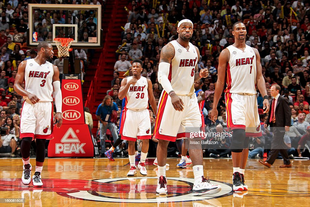 Miami Heat players, from left, Dwyane Wade #3, Norris Cole #30, LeBron James #6 and Chris Bosh #1 walk to the sideline for a timeout during a game against the Detroit Pistons on January 25, 2013 at American Airlines Arena in Miami, Florida.
