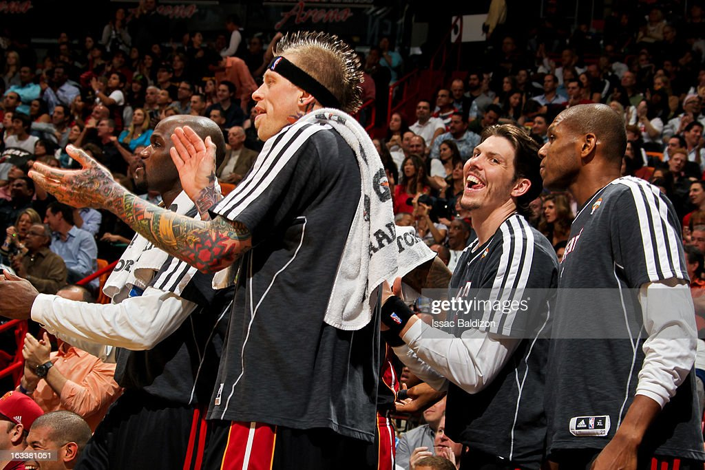 Miami Heat players, from left, Joel Anthony #50, Chris Andersen #11, Mike Miller #13 and James Jones #22 celebrate from the bench after a dunk by teammate Ray Allen #34 against the Philadelphia 76ers on March 8, 2013 at American Airlines Arena in Miami, Florida.