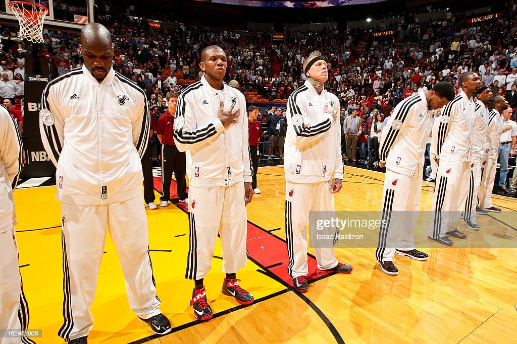 Miami Heat players, from left, Joel Anthony #50, James Jones #22, Chris Andersen #11, and Udonis Haslem #40, Chris Bosh #1, LeBron James #6 and Dwyane Wade #3 listen to the National Anthem before playing against the Memphis Grizzlies on March 1, 2013 at American Airlines Arena in Miami, Florida.